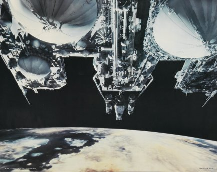 An unusual shot of the Nostromo (at center, nearest the planetoid) and the Refinery.