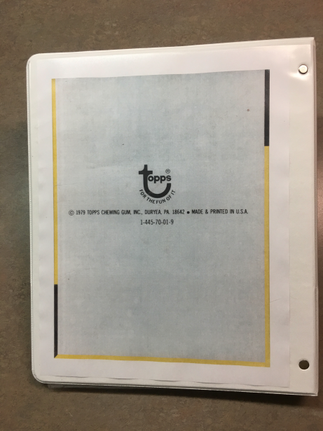 An image of the bottom of the box, used as back cover of the binder.